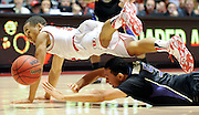 Utah Utes guard Brandon Taylor (11) dives over the top of Washington Huskies guard Nigel Williams-Goss (5) for a loose ball during a game at the Jon M. Huntsman Center on Thursday, February 6, 2014.
