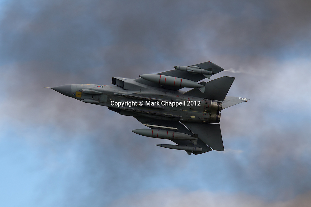 A pair of RAF Panavia Tornado GR4s in a ground attack capability demonstration  at the Cotswold Air Show/Best of Britain Show.  Cirencester, UNITED KINGDOM. August 26 2012..Photo Credit: Mark Chappell.© Mark Chappell 2012. All Rights Reserved. See instructions.
