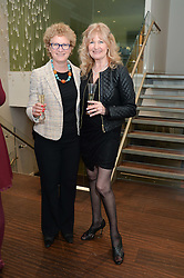 Left to right, SOPHIE MIRMAN and DEBBIE MOORE at a dinner in honour of Veuve Clicquot Business Woman Award UK Previous Winners held at Moet Hennessy, 18 Grosvenor Gardens, London on 8th April 2014.