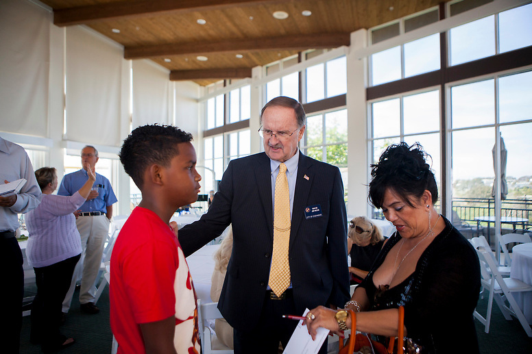 Lilia Pickens takes a photo of Oceanside Mayor and candidate for county supervisor Jim Wood with her 13-year-old son Nathan Edwards at a fundraiser on Sunday, May 5, 2014, at the Carlsbad Seapointe Resort.