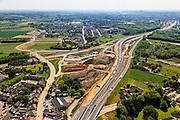 Nederland, Limburg, Maastricht, 27-05-2013; bouwwerkzaamheden voor de A2 traverse, De Groene Loper. <br /> Knooppunt Kruisdonk (A2 / A79), gezien richting centrum.<br /> De snelweg A2 gaat ondergronds, er wordt een gestapelde tunnel gebouwd (2 wegen boven elkaar). Het plan moet voor een betere bereikbaarheid en leefbaarheid van Maastricht zorgen en ook voor een betere doorstroming op de A2.<br /> Construction works for motorway A2 crossing Maastricht, the so-called Green Carpet.<br /> The A2 motorway goes underground, a stacked tunnel is  built with two roads above each other). The plan should provide better accessibility and traffic flow.<br /> luchtfoto (toeslag op standard tarieven);<br /> aerial photo (additional fee required);<br /> copyright foto/photo Siebe Swart.