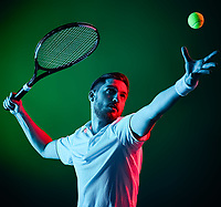 one caucasian tennis player man studio isolated on black background