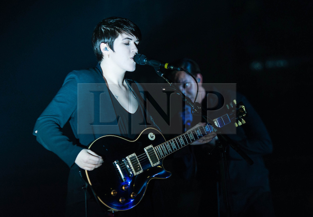 """© Licensed to London News Pictures. 16/12/2012. London, UK.   Romy Madley Croft (left) and Oliver Sim (right) of The XX performing live at O2 Academy Brixton. The xx are an English indie band, formed in London in 2008.  In 2010, the band won the Mercury Music Prize for their debut album, xx.  The band is composed of Romy Madley Croft (vocals, guitar),  Oliver Sim (vocalis, bass) , and .Jamie """"Jamie XX"""" Smith (percussion, producer). Photo credit : Richard Isaac/LNP"""