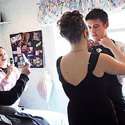 Nichole Delano, left, and Sarah York document the scene with their camera phones as Heather York helps Florian Maure, an exchange student from France, prepare for that uniquely American experience, namely, McKay High School's prom, April 21, 2007. THOMAS PATTERSON | Statesman Journal