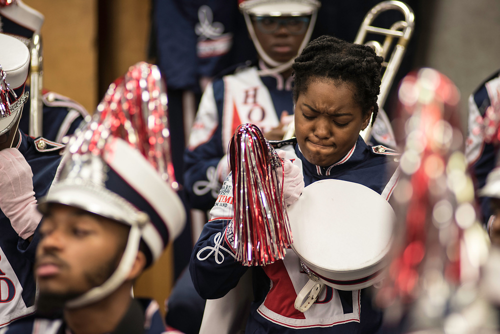 WASHINGTON,DC - October 7, 2017: Trumpet section leader Jalissa Douglas struggles with her plume as she gets dressed for the game.<br /> Howard University's Showtime Marching Band is part of a long tradition of outstanding bands at HBCU's. The band practices in the days leading up to a home game against North Carolina Central. (Andr&eacute; Chung for The Undefeated)