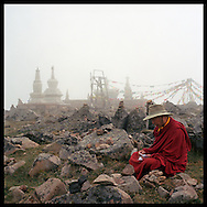 Khenpo prays on the top of one of the 5 Buddha mountains in Wu Tai Xian China.