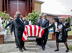 Pallbearers carry the flag-draped casket of Daniel Simmons Sr. out of the church after services Tuesday, July 30, 2015 at Greater St. Luke AME Church. Paul Zoeller/Staff