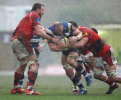 Bath's Carl Fearns is tackled - Photo mandatory by-line: Robbie Stephenson/JMP - Mobile: 07966 386802 - 29/03/2015 - SPORT - Rugby - Oxford - Kassam Stadium - London Welsh v Bath Rugby - Aviva Premiership
