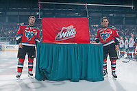 KELOWNA, CANADA - SEPTEMBER 20: Colten Martin #8 and Tyson Baillie #24 of Kelowna Rockets stands beside the BC Division Championship banner at the Kelowna Rockets raise it during the home opener against the Kamloops Blazers on September 20, 2014 at Prospera Place in Kelowna, British Columbia, Canada.   (Photo by Marissa Baecker/Shoot the Breeze)  *** Local Caption *** Colten Martin; Tyson Baillie;