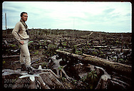 Tom Lovejoy atop stump in clearcut;World Wildlife studies Amazon remnants to gauge damage; Manaus Brazil