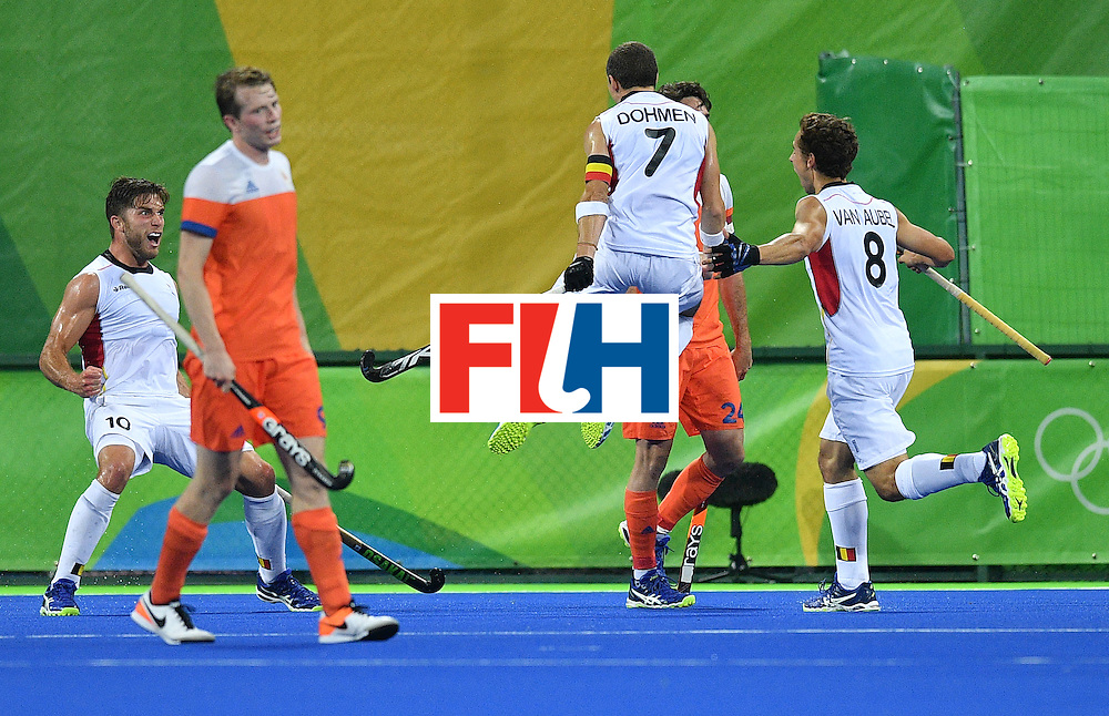 Belgium's John John Dohmen (C) celebrates a goal with teammates during the men's semifinal field hockey Belgium vs Netherlands match of the Rio 2016 Olympics Games at the Olympic Hockey Centre in Rio de Janeiro on August 16, 2016.  / AFP / Carl DE SOUZA        (Photo credit should read CARL DE SOUZA/AFP/Getty Images)