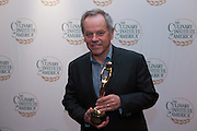 Wolfgang Puck with his award as a Pioneer of American Cuisine.