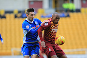 Matt Lund, Kyel Reid during the Sky Bet League 1 match between Bradford City and Rochdale at the Coral Windows Stadium, Bradford, England on 20 February 2016. Photo by Daniel Youngs.