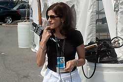 WCBS News Radio reporter Marla Diamond prepares for a live report from outise the press tent.