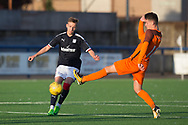 Dundee&rsquo;s Jack Lambert, who scored the only goal of the wee derby, is challenged by Dundee United's Logan Chalmers - Dundee under 20s v Dundee United in the SPFL Development League at Links Park, Montrose<br /> <br />  - &copy; David Young - www.davidyoungphoto.co.uk - email: davidyoungphoto@gmail.com