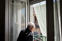 ACCIAROLI (POLLICA), ITALY - 5 OCTOBER 2016:  94-years-old Giuseppe Vassallo steps out on the balcony of his house in Acciaroli, a hamlet in the municipality of Pollica, Italy, on October 5th 2016. Giuseppe Vassallo was an Italian Navy official during WWII. At age 86, 8 years ago, Mr Vassallo had multiple sex affairs to overcome his depression following his wife's death. He was a testimonial of the Acciaroli's mediterranean  diet and lifestyle during Expo 2015, the Universal Exposition hostel in Milan last year.<br /> <br /> To understand how people can live longer throughout the world, researchers at University of California, San Diego School of Medicine have teamed up with colleagues at University of Rome La Sapienza to study a group of 300 citizens, all over 100 years old, living in Acciaroli (Pollica), a remote Italian village nestled between the ocean and mountains in Cilento, southern Italy.<br /> <br /> About 1-in-60 of the area's inhabitants are older than 90, according to the researchers. Such a concentration rivals that of other so-called blue zones, like Sardinia and Okinawa, which have unusually large percentages of very old people. In the 2010 census, about 1-in-163 Americans were 90 or older.