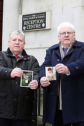 © Licensed to London News Pictures. 26/01/2016. Belfast, UK. Stanley McCombe (L) who lost his wife Ann ( in photo) and  Michael Gallagher who lost his son Aiden (in photo) in the 1998 Omagh Bomb,  stand outside the Royal Courts of Justice in Belfast, Northern Ireland. Relatives of the 29 people killed in the bombing have won the legal right to challenge the government's refusal to hold a public inquiry into the bombing. Photo credit : Paul McErlane/LNP