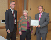 From left: Joseph Shields, Vice President for Research & Creative Activity and Dean of Ohio University's Graduate College along with Pam Benoit, Executive Vice President and Provost, congratulate Matthew Stallard for being a finalist for the Provost's Award for Excellence in Teaching during the 2016 Faculty Awards Recognition Ceremony held at Baker Center on Tuesday, September 6, 2016.
