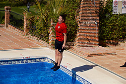 ALHAURÍN EL GRANDE, SPAIN - Tuesday, February 26, 2019: Wales' Tamsyn Sibanda jumps into the water of the hotel swimming pool during a training session at the at Alhaurin Golf Resort in Spain. (Pic by David Rawcliffe/Propaganda)