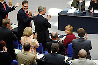 07 SEP 2005, BERLIN/GERMANY:<br /> Angela Merkel (M-Li), CDU Bundesvorsitzende und Kanzlerkandidatin, nach ihrer Rede, auf ihrem Platz in der CDU/CSU Fraktion, die ihr stehend applaudiert, letzte Bundestagsdebatte vor der Bundestagswahl, Plenum, Deutscher Bundestag<br /> Angela Merkel (M-Left), Chairwoman of the christian democratic party and candidate for chancellor, on her place in the CDU/CSU parliamentary group, what is giving her standing ovations after her speech, last sitting of the Bundestag before the general elections, plenary, Deutscher Bundestag<br /> IMAGE: 20050907-01-091<br /> KEYWORDS: Applaus, applause, applaudieren, klatschen, CDU Fraktion