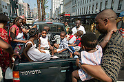 Fidelis Okonkwo, right, holds his 7-month-old daughter Obina as he and his family load into a pickup truck Wednesday, August 31, 2005, on Canal Street in New Orleans, La. Scott Morgan/Getty Images