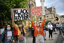 © Licensed to London News Pictures. 09/06/2020. Oxford, UK.  Campaigners gather at Oriel College at Oxford University, where they are calling for the removal of a statue of controversial imperialist Cecil Rhodes. Black Lives Matter protesters recently pulled down a statue of slave trader Edward Colston in Bristol town centre, following the death of George Floyd in the U. S. A . Photo credit: Ben Cawthra/LNP