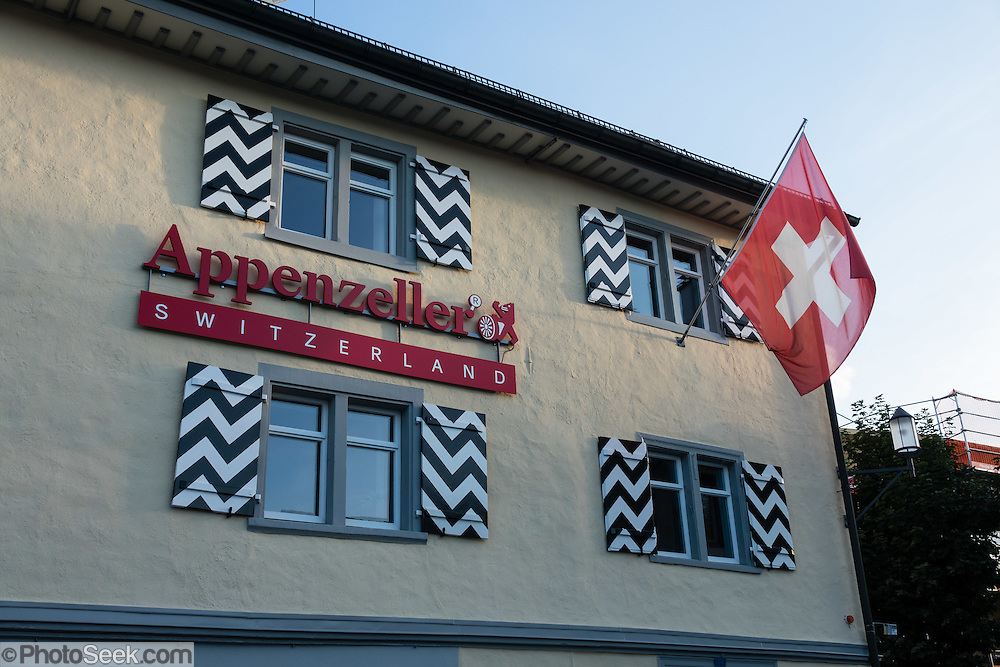 Appenzeller label and Swiss flag on building in Appenzell village, Switzerland, Europe. Appenzell Innerrhoden is Switzerland's most traditional and smallest-population canton (second smallest by area).