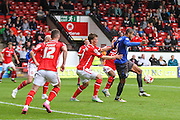 Bury's Leon Clarke holds off the Walsall defenders during the Sky Bet League 1 match between Walsall and Bury at the Banks's Stadium, Walsall, England on 5 September 2015. Photo by Shane Healey.