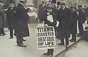London newspaper seller with banner announcing the loss of SS Titanic in 1912.