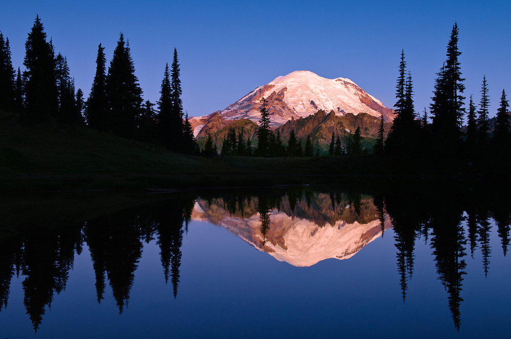Mount Rainier and reflection in Upper Tipsoo Lake at sunrise; Mount Rainier National Park, Washington.