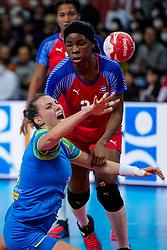 05-12-2019 JAP: Cuba - Slovenia, Kumamoto<br /> Fourth match groep A at 24th IHF Womenís Handball World Championship. Slovenia win 39 - 26 of Cuba / Teja Ferfolja #15 of Slovenia, Nahomi Marquez Jabique #24 of Cuba
