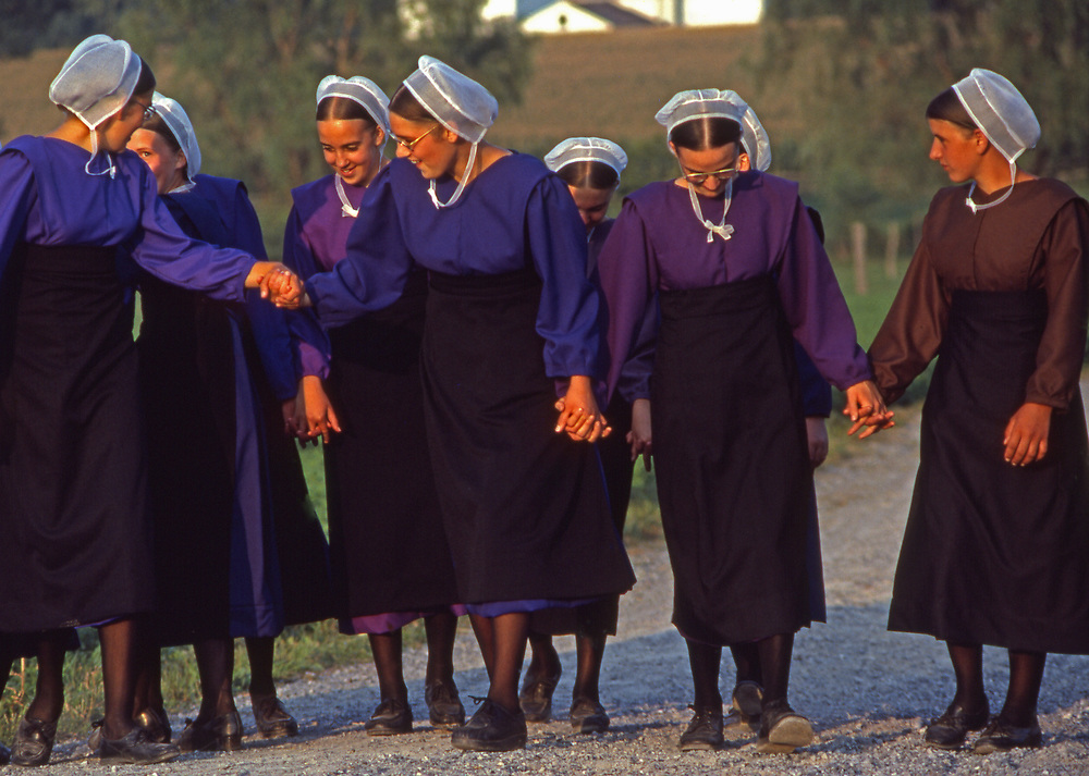 Old Order Amish female youth enjoy one another at youth outing, Lancaster Co., PA