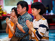04 SEPTEMBER 2017 - BANGKOK, THAILAND: People pray after donating rice and cooking oil to Chaomae Thapthim Shrine. About 1,000 people came to the shrine for the annual food distribution. Staples, like rice and cooking oil, are donated to the shrine throughout the year and donated to poor people from the communities around the shrine. Food distributions like this are a tradition at Chinese shrines in Bangkok and a common way of making merit for the people who donate the staples.     PHOTO BY JACK KURTZ