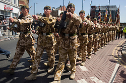 Freedom Parade. Soldiers from the 3rd Battalion The Yorkshire Regiment march through the streets of Barnsley South Yorkshire with Swords drawn, bayonets fixed, bands playing and colours flying as the Regiment is granted the freedom of the borough<br />