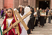 07 APRIL 2004 - SAN MIGUEL DE ALLENDE, GUANAJUATO, MEXICO: Women participate in a Holy Wednesday Stations of the Cross procession through San Miguel de Allende, GTO, MEX. Semana Santa, the week before Easter is celebrated with extreme piety in central Mexico. San Miguel, which was founded in the 1600s, is one of Mexico's premier colonial cities. It has very strict zoning and building codes meant to preserve the historic nature of the city center. About 7,500 US citizens, mostly retirees, live in San Miguel. PHOTO BY JACK KURTZ