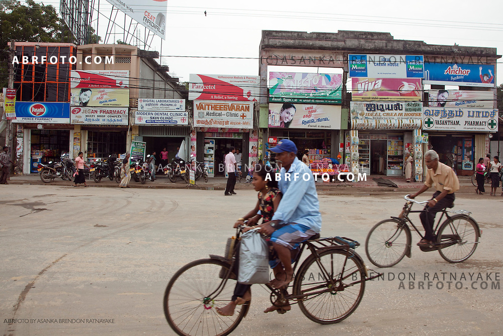 Locals cycling along the main street of Jaffna town.