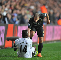 Manchester City's Pablo Zabaleta helps up Swansea City's Roland Lamah - Photo mandatory by-line: Alex James/JMP - Tel: Mobile: 07966 386802 01/01/2014 - SPORT - FOOTBALL - Liberty Stadium - Swansea - Swansea City v Manchester City - Barclays Premier League