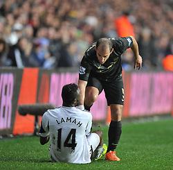Manchester City's Pablo Zabaleta helps up Swansea City's Roland Lamah - Photo mandatory by-line: Alex James/JMP - Tel: Mobile: 07966 386802 01/01/2014 - SPORT - FOOTBALL - Liberty Stadium - Swansea - Swansea City v Manchester City - Barclays Premier League