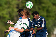 Rice's Hayden Kjelleran (23) and Burlington's Julian Segar-Reed (20) battle to head the ball during the boys soccer game between the The Burlington Seahorses and the Rice Green Knights at Rice Memorial high School on Tuesday afternoon September 15, 2015 in South Burlington, Vermont. (BRIAN JENKINS/for the FREE PRESS)