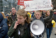 Windsor, Canada, 2014. Emily Davidson, foreground and Lauren Whalen, with loud speaker, march with others down Oulelette Avenue during the annual May Day march and rally.