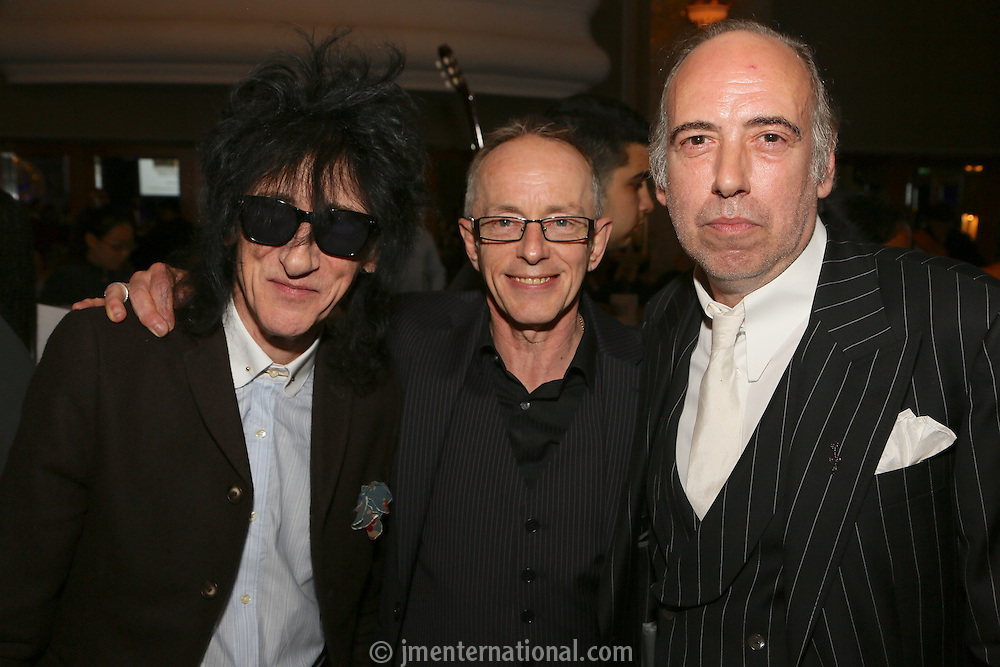 (L-R) John Cooper Clark, Nick Headon and MIck Jones. The Silver Clef Lunch 2013 in aid of  Nordoff Robbins held at the London Hilton, Park Lane, London.<br /> Friday, June 28, 2013 (Photo/John Marshall JME)