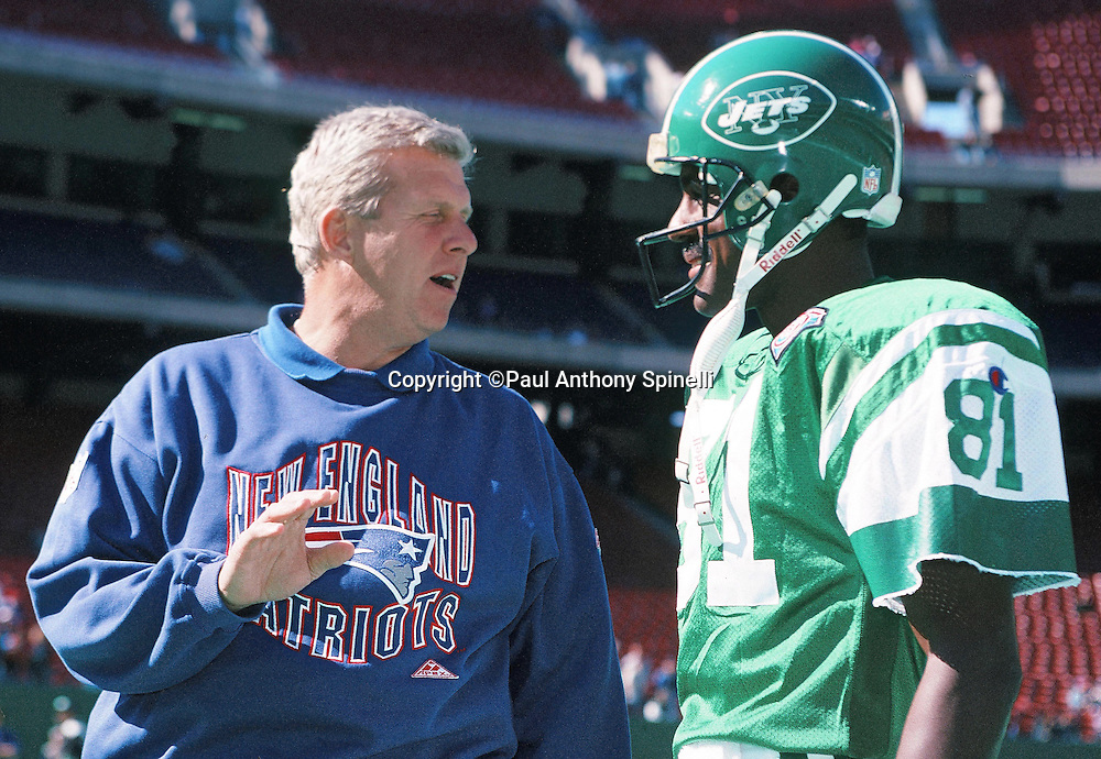 New England Patriots head coach Bill Parcells talks to a smiling New York Jets wide receiver Art Monk (81) before the NFL football game against the New York Jets on Oct. 16, 1994 in East Rutherford, N.J. The Jets won the game 24-17. (©Paul Anthony Spinelli)