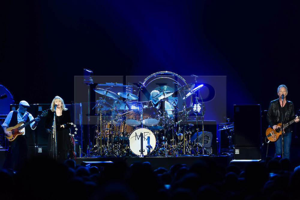 © Licensed to London News Pictures. 24/09/2013. London, UK.   Fleetwood Mac performing live at The O2 Arena.  In this pic - John McVie (1st from left), Stevie Nicks (2nd from left), Mick Fleetwood (centre), Lindsey Buckingham (right).  Fleetwood Mac are a British-American rock band formed in 1967 in London consisting of Mick Fleetwood (drums), John McVie (bass), Lindsey Buckingham (guitar/vocals) and Stevie Nicks (vocals).  Photo credit : Richard Isaac/LNP