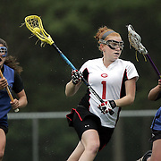 Rye, NY / 2009 - Rye's Molly O'Brien, center, runs up field with the ball as Pearl River's Lauren Cook, right, and Shannon Howe, left, play defense during the Class C girls semifinal lacrosse game between Rye and Pearl River at Rye High School. Rye won the game 14-13. ( Mike Roy / The Journal News )