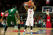 DALLAS, TX - JANUARY 15: Markus Kennedy #5 of the SMU Mustangs brings the ball up court against the South Florida Bulls on January 15, 2014 at Moody Coliseum in Dallas, Texas.  (Photo by Cooper Neill/Getty Images) *** Local Caption *** Markus Kennedy