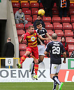 Dundee's Julen Etxabeguren out jumps Partick Thistle&rsquo;s Ryan Stevenson - Partick Thistle v Dundee, Ladbrokes Premiership at Firhill<br /> <br />  - &copy; David Young - www.davidyoungphoto.co.uk - email: davidyoungphoto@gmail.com