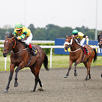 Shaunas Spirit and Paul Booth winning the 6.20 race