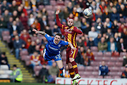 Nicky Law of Bradford City and Gillingham midfielder Mark Byrne contest an aerial ball  during the EFL Sky Bet League 1 match between Bradford City and Gillingham at the Northern Commercials Stadium, Bradford, England on 24 March 2018. Picture by Paul Thompson.