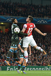LONDON, ENGLAND - Oct 01: Napoli's defender Raul Albiol from Spain and Arsenal's forward Olivier Giroud from France compete for the ball during the UEFA Champions League match between Arsenal from England and Napoli from Italy played at The Emirates Stadium, on October 01, 2013 in London, England. (Photo by Mitchell Gunn/ESPA)