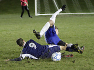 Susquehanna Valley's Justin Caroway (9) knocks over Seth Scarano of Ichabod Crane with a sliding tackle during a Class B state semifinal game at Faller Field in Middletown on Saturday, Nov. 17, 2012.
